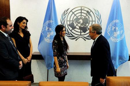International human rights lawyer Amal Clooney arrives with Yazidi survivor Nadia Murad (C) to meet with United Nations Secretary General, Antonio Guterres, at U.N. headquarters in New York, U.S., March 10, 2017.  REUTERS/Lucas Jackson
