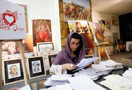 A member of the ArtLords sorts letters of Dard-e-Dil project in Kabul