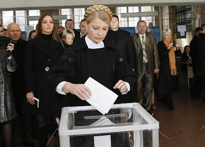This handout picture taken by the Batkivschyna party shows the leader of the party and former Ukrainian prime minister, Yulia Tymoshenko, casting her ballot in a polling station on October 26, 2014 (AFP Photo/Alexander Prokopenko)