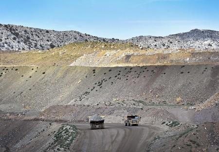 FILE PHOTO: Heavy mining equipment haul overburden material across Molycorp's Mountain Pass Rare Earth facility in Mountain Pass, California