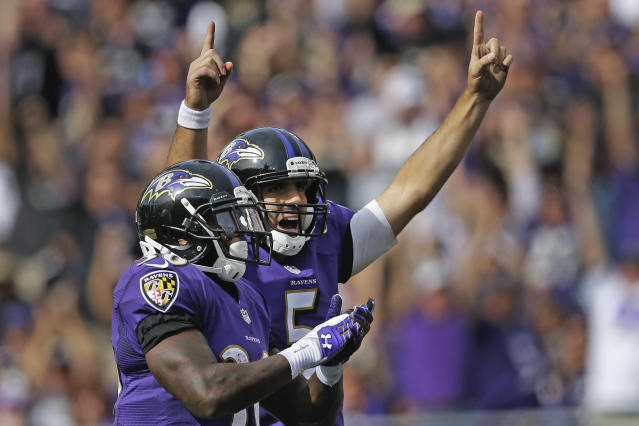 Baltimore Ravens running back Bernard Pierce, left, and quarterback Joe Flacco celebrate wide receiver Marlon Brown's touchdown during the second half of an NFL football game against the Cleveland Browns in Baltimore, Md., Sunday, Sept. 15, 2013. (AP Photo/Patrick Semansky)