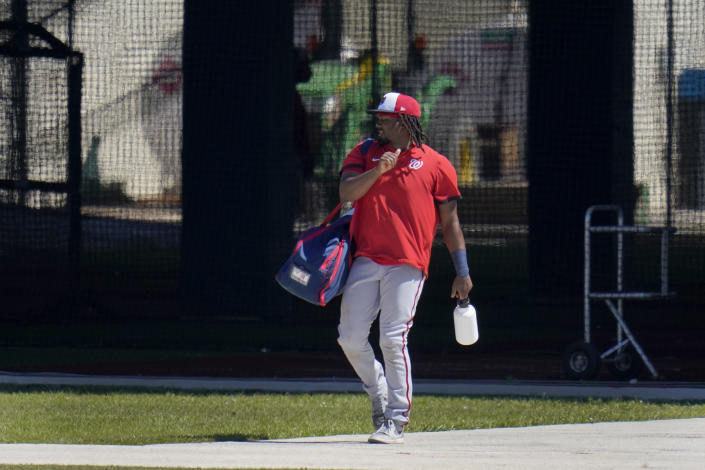 Washington Nationals' Josh Bell leaves the batting cages during spring training baseball practice Thursday, Feb. 25, 2021, in West Palm Beach, Fla. (AP Photo/Jeff Roberson)