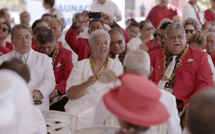 Prime Minister-elect Fiame Naomi Mata'afa, center with fan, dits with her supporters Monday, May 24, 2021, in Apia, Samoa - Australia Broadcasting Corporation