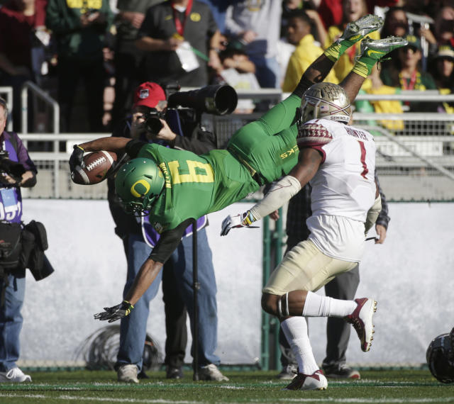 Oregon wide receiver Charles Nelson, left, dives just short of the goal line over Florida State safety Tyler Hunter during the first half of the Rose Bowl NCAA college football playoff semifinal, Thursday, Jan. 1, 2015, in Pasadena, Calif. (AP Photo/Jae C. Hong)