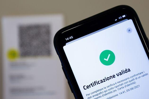 The VerificaC19 app, a smartphone app designed to scan and check the Green Pass (health pass) which has become mandatory to access an array of services and leisure activities, is seen on a mobile phone, amid the coronavirus disease (COVID-19) pandemic, in this illustration picture taken in Rome, Italy, August 5, 2021. Picture taken August 5, 2021. REUTERS/Guglielmo Mangiapane/Illustration (Photo: Guglielmo Mangiapane via Reuters)