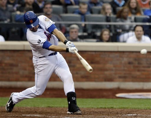 New York Mets' Mike Nickeas hits a two-run single during the fourth inning of a baseball game against the Arizona Diamondbacks, Saturday, May 5, 2012, in New York. (AP Photo/Frank Franklin II)