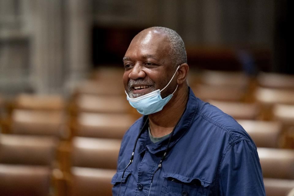 Artist Kerry James Marshall, who has been selected to design a replacement of former Confederate-themed stained glass windows that were taken down in 2017 at the National Cathedral, stands in Washington, Thursday, Sept. 23, 2021. The Cathedral has also commissioned Pulitzer-nominated poet Elizabeth Alexander to pen a poem that will be inscribed in the stone beneath the new windows. (AP Photo/Andrew Harnik)