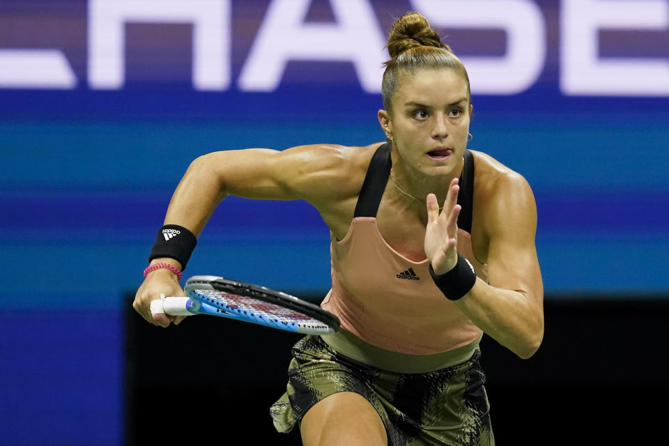 Maria Sakkari, of Greece, chases down a shot from Emma Raducanu, of Great Britain, during the semifinals of the US Open tennis championships, Thursday, Sept. 9, 2021, in New York. (AP Photo/Elise Amendola)