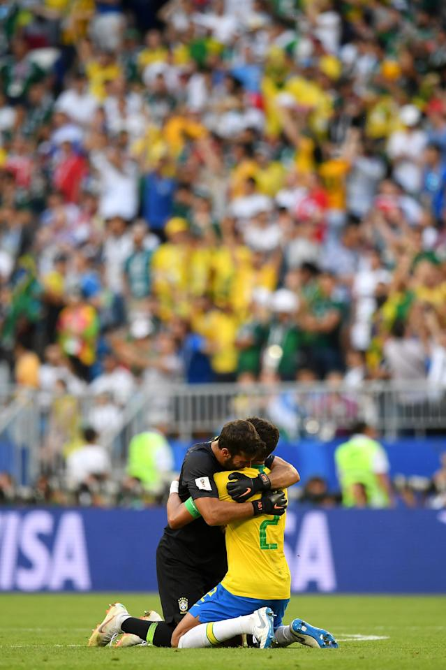 <p>Alisson of Brazil and Thiago Silva of Brazil celebrate after teammate Roberto Firmino scores their sides second goal during the 2018 FIFA World Cup Russia Round of 16 match between Brazil and Mexico at Samara Arena on July 2, 2018 in Samara, Russia. (Photo by Matthias Hangst/Getty Images) </p>