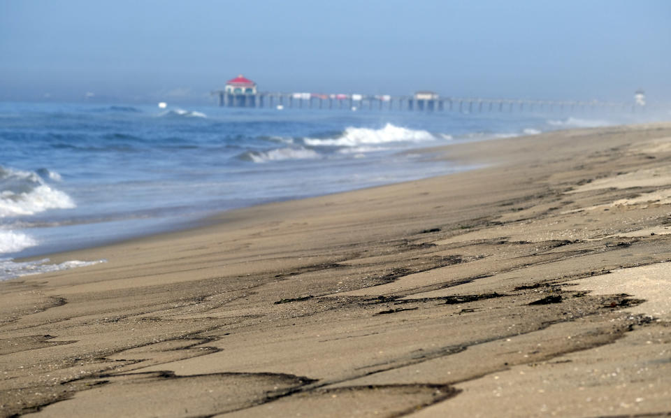 Part of an oil spill washes up on the beach south of the Pier in Huntington Beach, Calif., Sunday, Oct. 3, 2021. (AP Photo/Ringo H.W. Chiu)