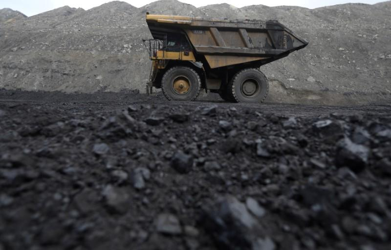 FILE PHOTO: Dump trucks haul coal and sediment at the Black Butte coal mine outside Rock Springs, Wyoming, United States