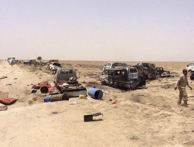 FILE - In this June 29, 2016, file photo, Iraqi security forces inspect vehicles belonging to escaping Islamic State militants outside Fallujah, Iraq. (AP Photo, file)