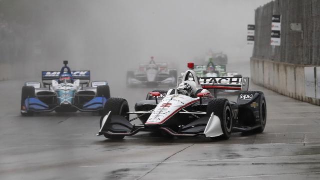 Josef Newgarden (2) drives through a turn during the first race of the IndyCar Detroit Grand Prix auto racing doubleheader, Saturday, June 1, 2019, in Detroit. (AP Photo/Carlos Osorio)