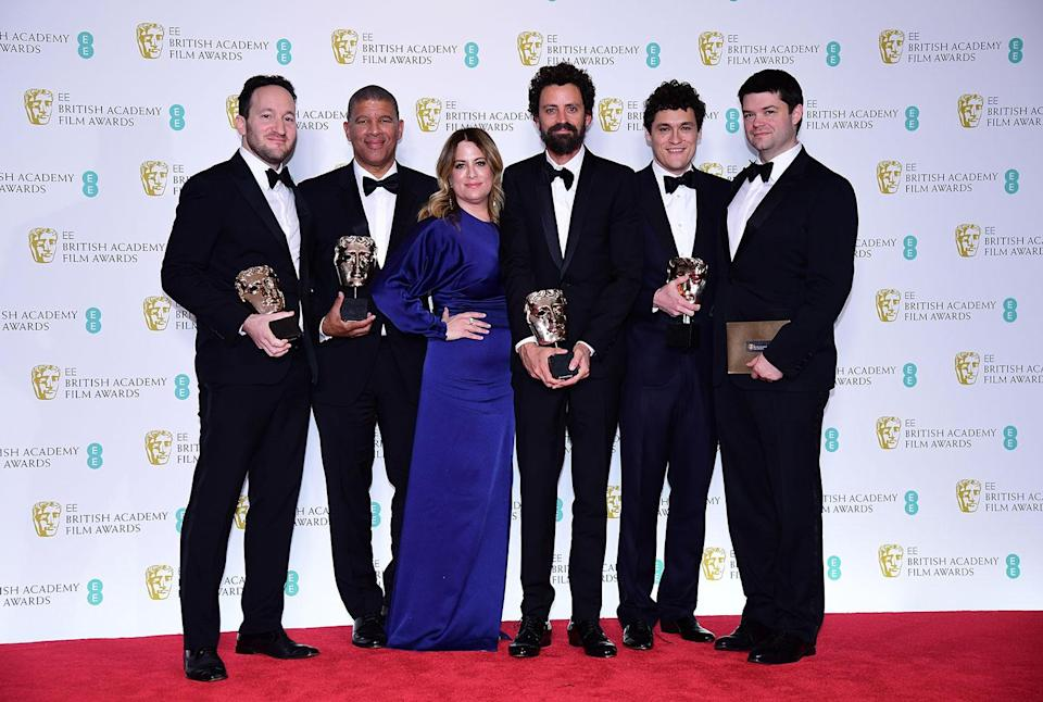 The crew of <i>Spider-Man: Into the Spider-Verse</i> with their Best Animated Film bafta in the press room at the 72nd British Academy Film Awards. (Ian West/PA)