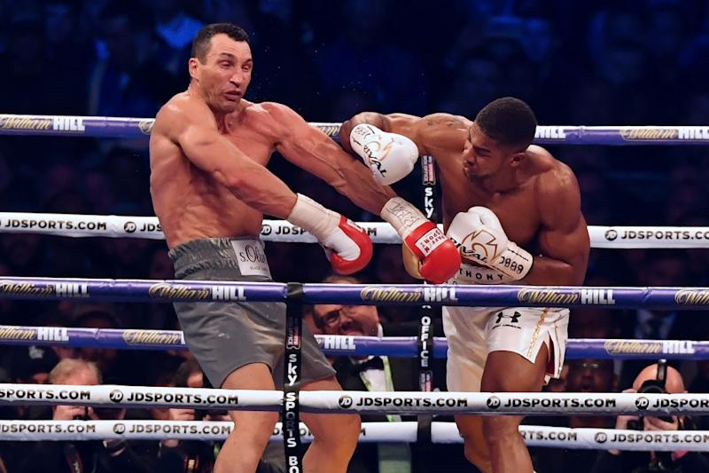 Joshua signs 2 fight Wembley stadium deal
