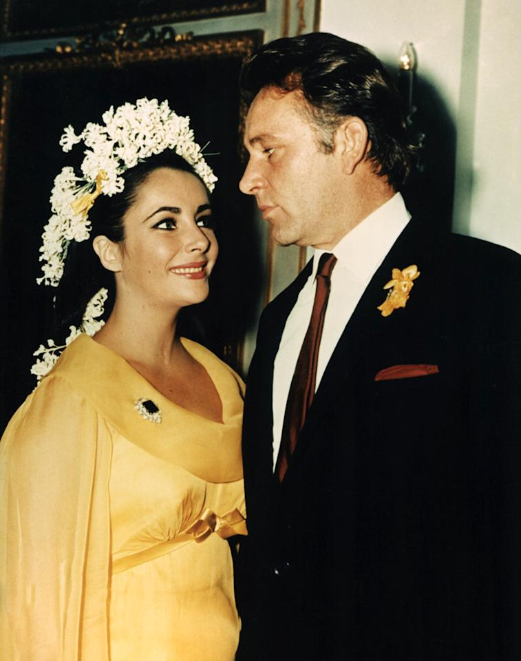 When you get married as many times as Elizabeth Taylor did (eight times to seven different guys!) it's easy to get sick of white. The iconic actress chose this yellow, long-sleeve dress created by costume designer Irene Sharaff when she got married for the fifth time and wed Richard Burton in 1964 wedding to Richard Burton. She recycled the husband, not the dress, when she remarried Burton 11 y ears later.