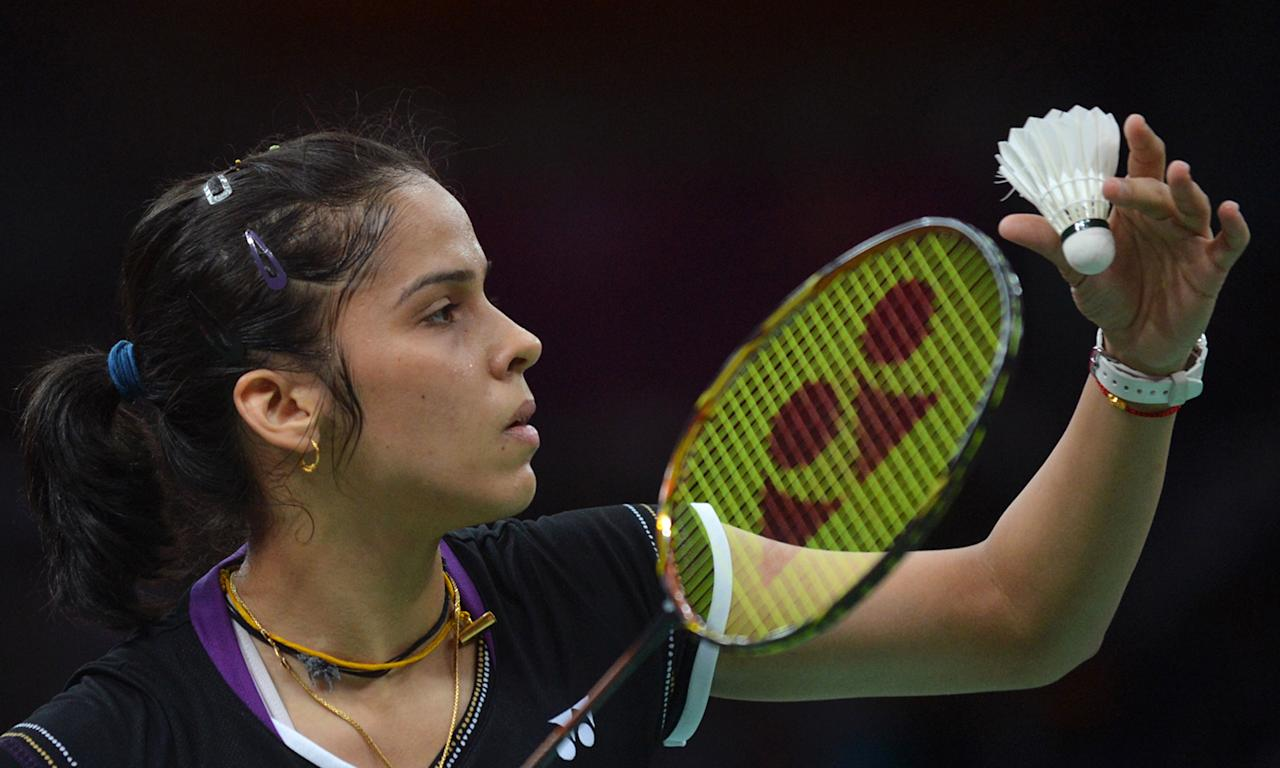 India's Saina Nehwal plays a shot to Lianne Tan of Belgium during their womens singles badminton match at the London 2012 Olympic Games in London on July 30, 2012. Nehwal won 21-4, 21-14.     AFP PHOTO/ ADEK BERRY