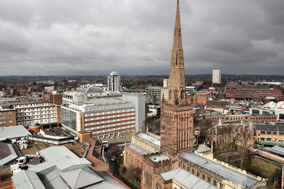 Coventry in West Midlands, England. Old town aerial view from ruined cathedral tower. Prominent Holy Trinity Church.