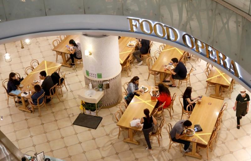 Tables and chairs are taped up to encourage social distancing, due to the outbreak of the coronavirus disease (COVID-19), at a food court in Singapore