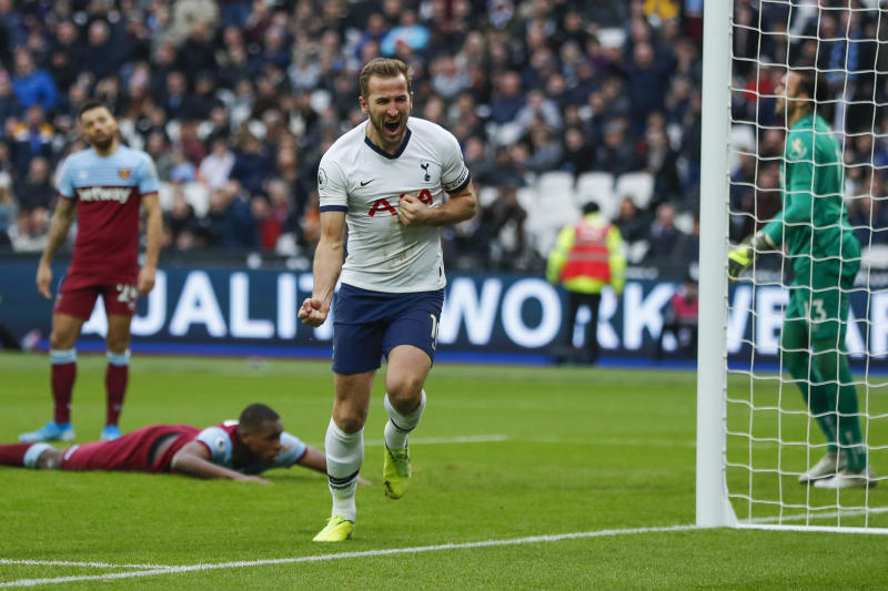 Tottenham's Harry Kane, center, celebrates after he scored his side's third goal during the English Premier League soccer match between West Ham and Tottenham, at London stadium, in London, Saturday, Nov. 23, 2019.(AP Photo/Frank Augstein)