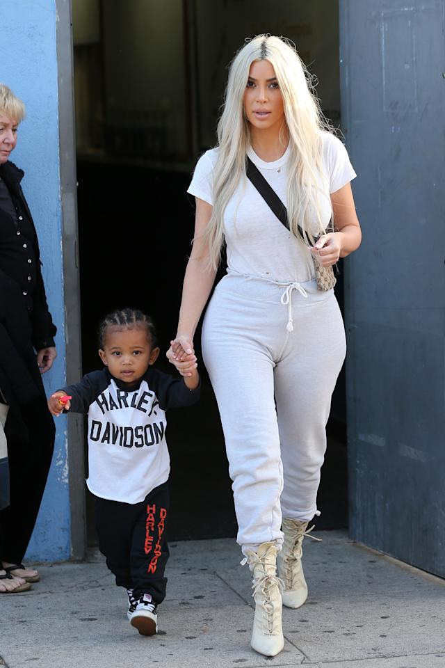 <p>In a white tee, grey drawstring sweatpants, Gucci sling bag, and Yeezy lace-up booties while out her with family (including little Saint West) in Los Angeles.</p>