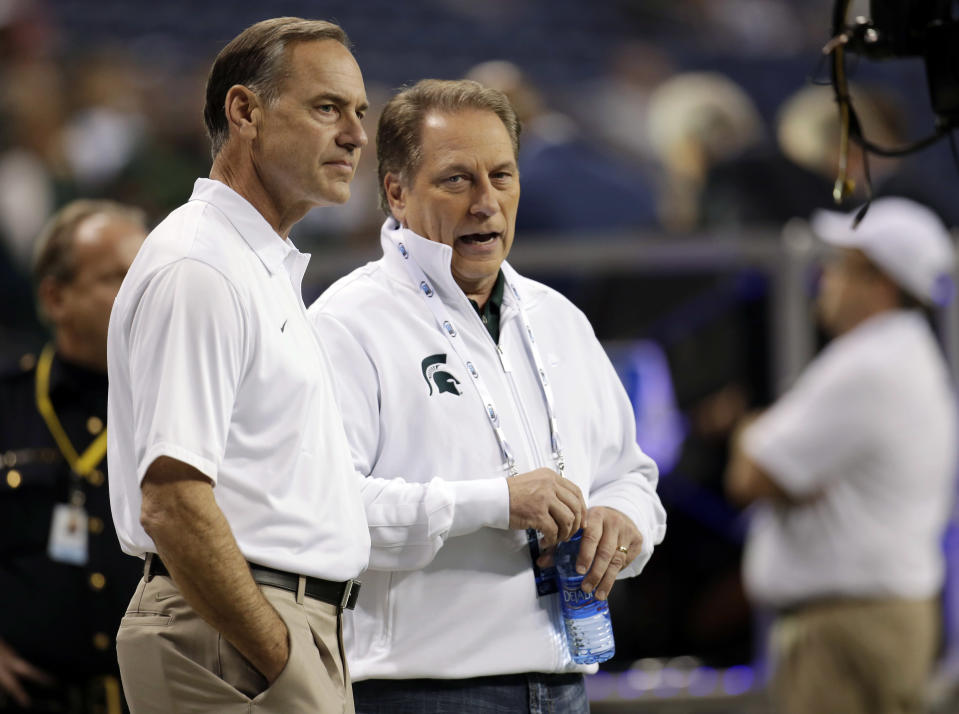 Mark Dantonio, left, and Tom Izzo may be targeted in the Michigan State abuse scandal. (AP)