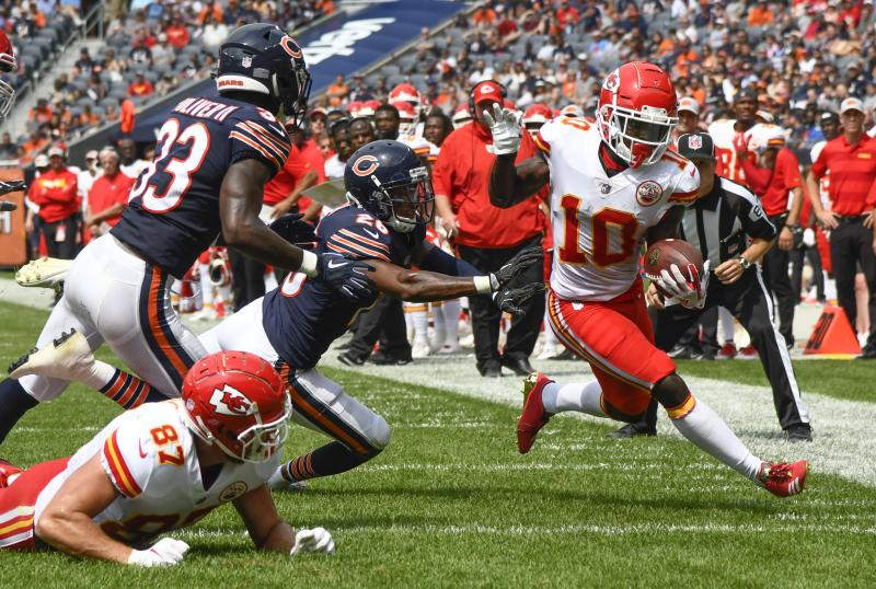 Kansas City Chiefs' Tyreek Hill is knocked out of bounds during the second half of a preseason NFL football game against the Chicago Bears Saturday, Aug. 25, 2018, in Chicago. (AP Photo/Matt Marton)
