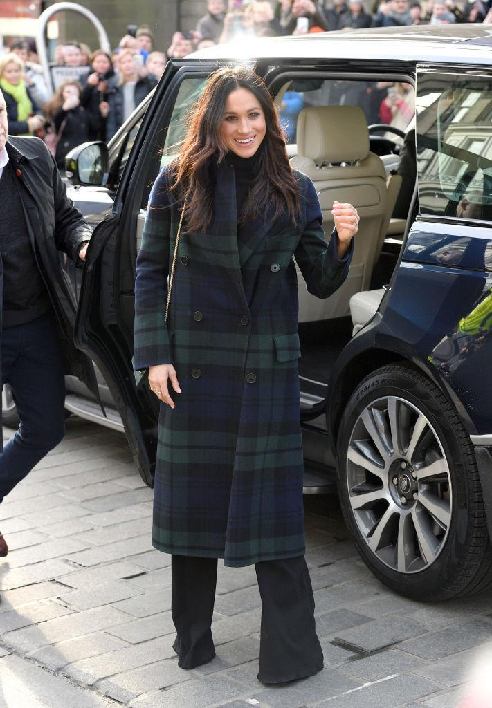 """<p>On February 13th, Prince Harry and bride-to-be Meghan Markle made their visit joint trip to <a href=""""https://uk.style.yahoo.com/meghan-markle-flies-scottish-flag-tartan-coat-strathberry-bag-edinburgh-trip-122954621.html"""" data-ylk=""""slk:Edinburgh;outcm:mb_qualified_link;_E:mb_qualified_link;ct:story;"""" class=""""link rapid-noclick-resp yahoo-link"""">Edinburgh</a>. And to celebrate the Scottish capital, the 36-year-old opted for a tartan double-breasted coat by <a href=""""https://www.net-a-porter.com/gb/en/product/992863?cm_mmc=LinkshareUK-_-gcdL/ATRVoE-_-Custom-_-LinkBuilder&siteID=gcdL_ATRVoE-gH1pIsSzp5E_Cqbl2TE_dQ&Lyst=Lyst"""" rel=""""nofollow noopener"""" target=""""_blank"""" data-ylk=""""slk:Burberry"""" class=""""link rapid-noclick-resp"""">Burberry</a> (£1,995). The former actress teamed the aesthetic with flared Veronica Beard <a href=""""https://www.bergdorfgoodman.com/Veronica-Beard-Shore-Sailor-Wide-Leg-Pants-Black/prod129070015/p.prod"""" rel=""""nofollow noopener"""" target=""""_blank"""" data-ylk=""""slk:trousers"""" class=""""link rapid-noclick-resp"""">trousers</a> (which she already owned) and a cross-body bag by Scottish brand, <a href=""""http://www.lanecrawford.com/product/strathberry/-east-west-mini-leather-flap-suede-crossbody-bag/_/ABR143/product.lc?countryCode=US&utm_source=Affiliates&utm_medium=Affiliates&utm_campaign=Linkshare_US&_country=US"""" rel=""""nofollow noopener"""" target=""""_blank"""" data-ylk=""""slk:Strathberry"""" class=""""link rapid-noclick-resp"""">Strathberry</a> (£274). <em>[Photo: Getty]</em> </p>"""