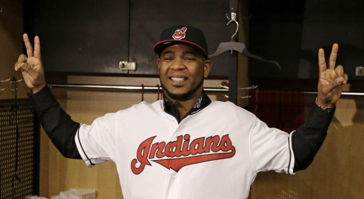 Cleveland Indians' Edwin Encarnacion smiles wearing a Cleveland Indians baseball jersey, Thursday, Jan. 5, 2017, in Cleveland. One win from a World Series title last season, the Indians finalized a $60 million, three-year contract with free agent slugger Encarnacion. (AP Photo/Tony Dejak)