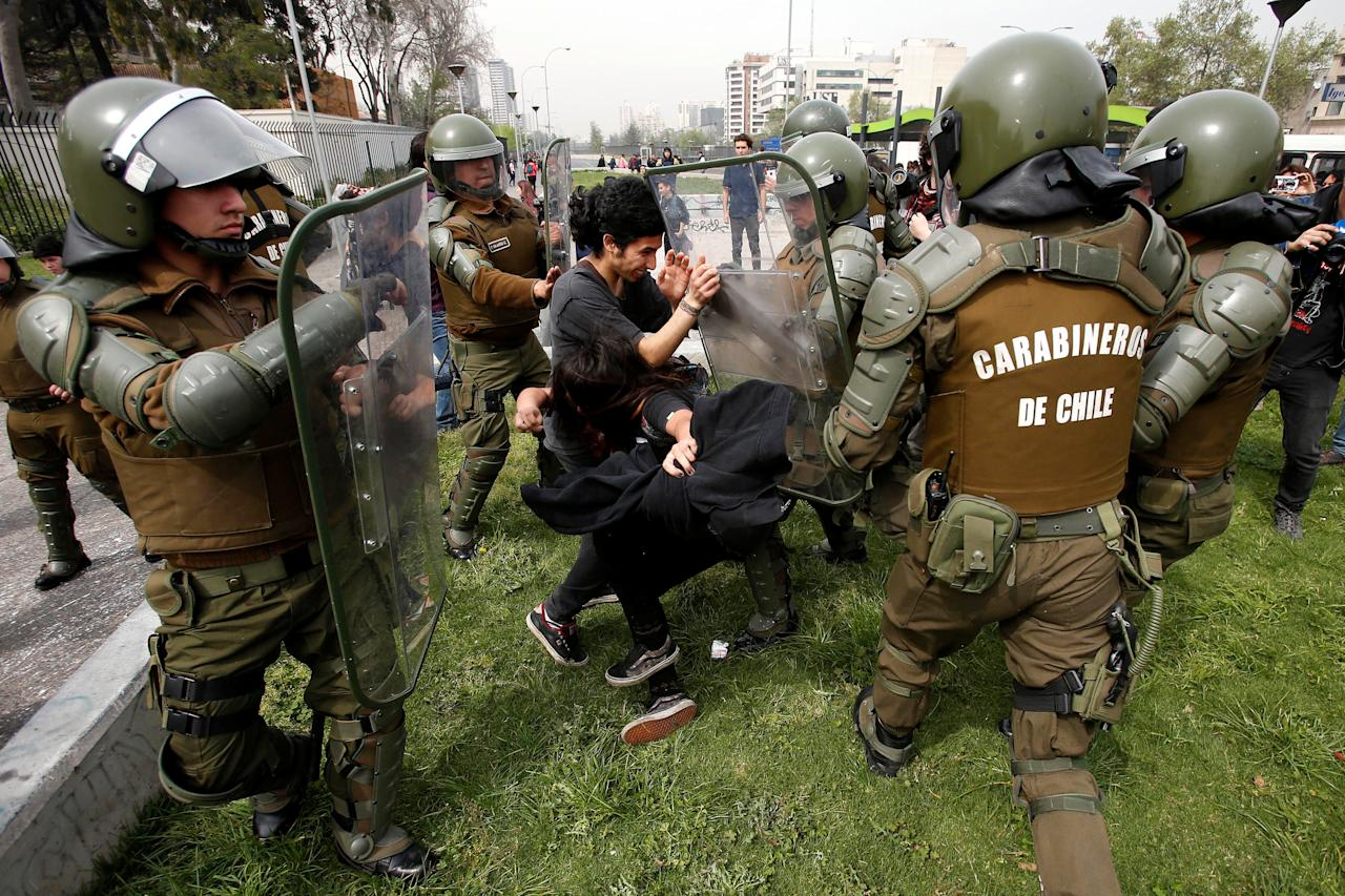 Demonstrators are detained during a rally to request change in the education system in Santiago, Chile September 27, 2017. REUTERS/Carlos Vera