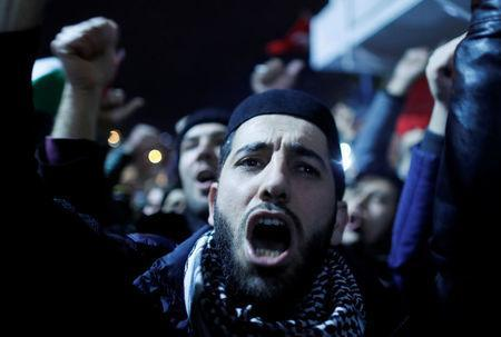 Demonstrators shout slogans during a protest against the U.S. intention to move its embassy to Jerusalem and to recognise the city of Jerusalem as the capital of Israel, near the U.S. Consulate in Istanbul, Turkey, December 6, 2017. REUTERS/Osman Orsal