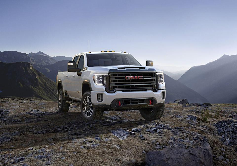 "<p><a href=""https://www.caranddriver.com/gmc/sierra-2500hd-3500hd"" rel=""nofollow noopener"" target=""_blank"" data-ylk=""slk:GMC's HD Sierra"" class=""link rapid-noclick-resp"">GMC's HD Sierra </a>line is built to undertake mighty tasks such as towing toy haulers the size of a house. But the All Terrain X package provides some trail-crawling credentials, too. The Off-Road Suspension package uses twin-tube shocks, hill-descent control, transfer-case protection, and a set of aggressively treaded Goodyear Wrangler DuraTrac tires. The bed-mounted roll bars are a bit tacky, but the front skid plate and trailer-tow mirrors are plenty useful. Available on four-wheel-drive SLT models, the All-Terrain X equipment goes well with either the standard 360-hp 6.0-liter V-8 or the almighty Duramax diesel 6.6-liter V-8 that thunders with 910 lb-ft of torque.</p>"