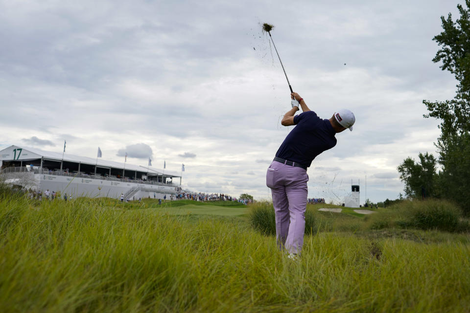 Justin Thomas hits from the rough on the 17th hole in the second round at the Northern Trust golf tournament, Friday, Aug. 20, 2021, at Liberty National Golf Course in Jersey City, N.J. (AP Photo/John Minchillo)