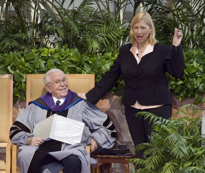 FILE - In this Oct. 24, 2010 file photo, Sheila Schuller Coleman, right, stands next to her father, Robert H. Schuller, as she delivers her sermon on Sunday, Oct. 24, 2010. The Crystal Cathedral is getting a new name and the congregation of the financially struggling Orange County megachurch will relocate, its senior pastor announced Sunday. The ministry will be renamed Hope Center of Christ, Sheila Schuller Coleman said in a short video posted on the Crystal Cathedral website. An announcement regarding the new location will be made in the next few weeks, she said. (AP Photo/Orange County Register, Ana Venegas, File) MAGS OUT; LOS ANGELES TIMES OUT