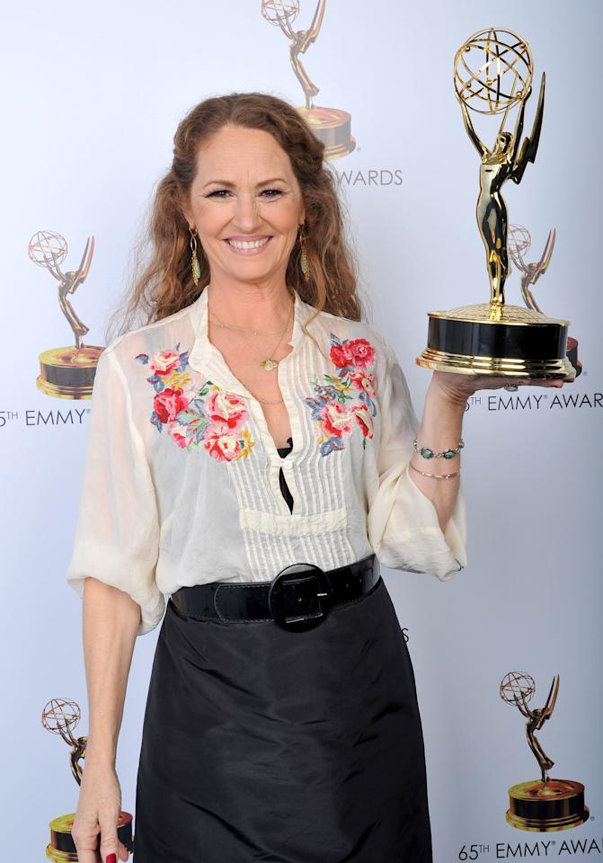 Melissa Leo poses for a portrait at the 2013 Primetime Creative Arts Emmy Awards, on Sunday, September 15, 2013 at Nokia Theatre L.A. Live, in Los Angeles, Calif. (Photo by Vince Bucci/Invision for Academy of Television Arts & Sciences/AP Images)