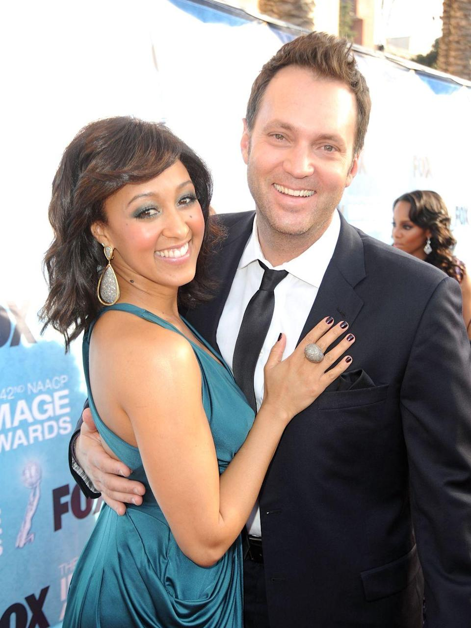 "<p>The <em>Sister, Sister</em> actress met her husband through their economics professor, Robert Sexton, at Pepperdine University. Housley noticed Mowry on the photo wall of Sexton's favorite students near his desk. </p><p>""Tia was on the wall too, my twin, but he pointed to my picture,"" Mowry <a href=""https://www.yahoo.com/lifestyle/tamera-mowry-fox-news-corresponded-adam-housley-dealt-lot-racial-junk-getting-married-183832906.html"" data-ylk=""slk:said to Yahoo!.;outcm:mb_qualified_link;_E:mb_qualified_link;ct:story;"" class=""link rapid-noclick-resp yahoo-link"">said to <em>Yahoo!</em>.</a> </p><p>At the time, she was focused on her career and told the professor to give Housley her email. She wasn't interested in a relationship and thought it would be easier to let the potential suitor down virtually. Her mind soon changed, though, when she received Housley's email. </p><p>""I always say, 'He got me with his words,'"" Mowry has said. They married in 2011 and have two children together. </p>"