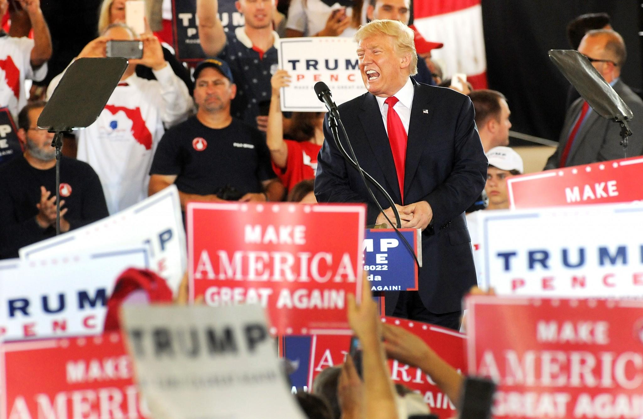 Republican presidential nominee Donald Trump greets supporters during a rally at Southeastern Livestock Pavilion on October 12, 2016, in Ocala, Fla.