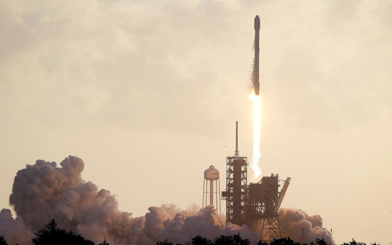 Falcon 9 SpaceX rocket carrying a classified satellite lifts off from Kennedy Space Center in Cape Canaveral - Credit: AP/John Raoux