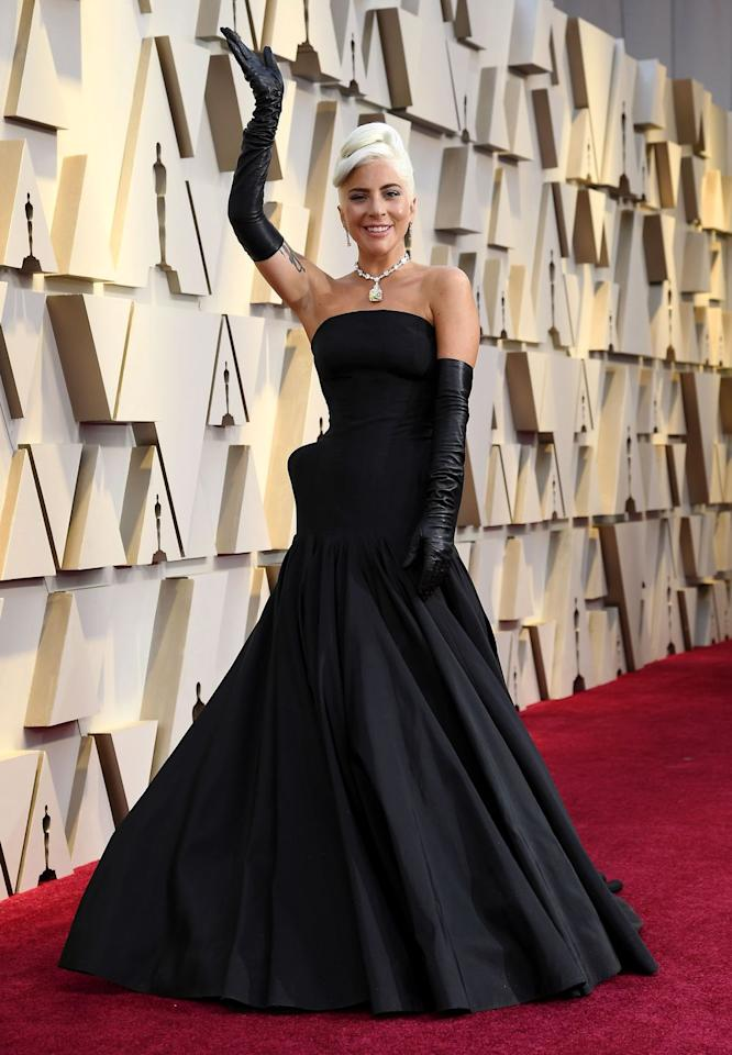 <p>If you choose to frame just one moment of Gaga's <em>A Star Is Born</em> journey, let it be this red carpet look by Alexander McQueen. From the black gloves to her perfectly coiffed hair to that 128 carat Tiffany yellow diamond (which, FYI, was last worn by Audrey Hepburn in <em>Breakfast at Tiffany's</em>), Gaga was a literal star at the Oscars. Bravo!<em></em></p>