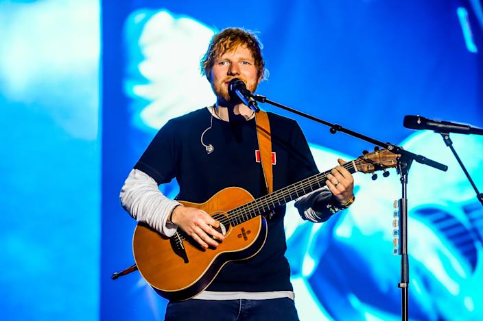 Ed Sheeran performs on stage