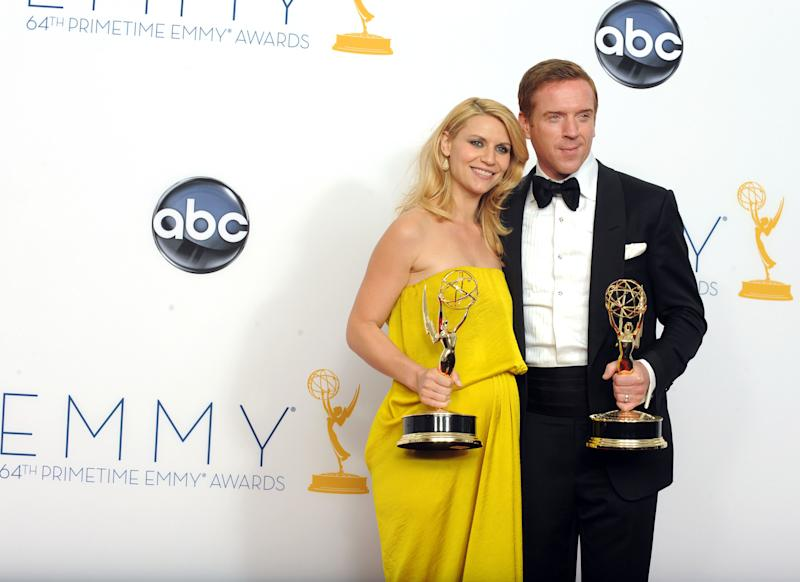 "FILE - This Sept. 23, 2012 photo shows actress Claire Danes, winner of the Emmy for Outstanding Lead Actress In A Drama Series for ""Homeland"" and Actor Damian Lewis, winner Outstanding Lead Actor In A Drama Series for ""Homeland"" posing backstage at the 64th Primetime Emmy Awards at the Nokia Theatre in Los Angeles. The second season of the Emmy award-winning series premieres Sunday at 10p.m. EST on Showtime. (Photo by Jordan Strauss/Invision/AP)"