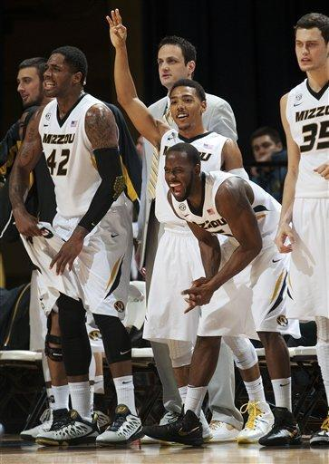 Missouri players Alex Oriakhi, from left, Phil Pressey, Keion Bell and Stefan Jankovic celebrate a teammate's 3-point shot during the first half of an NCAA college basketball game against Vanderbilt on Saturday, Jan. 26, 2013, in Columbia, Mo. Missouri won the game 81-59. (AP Photo/L.G. Patterson)