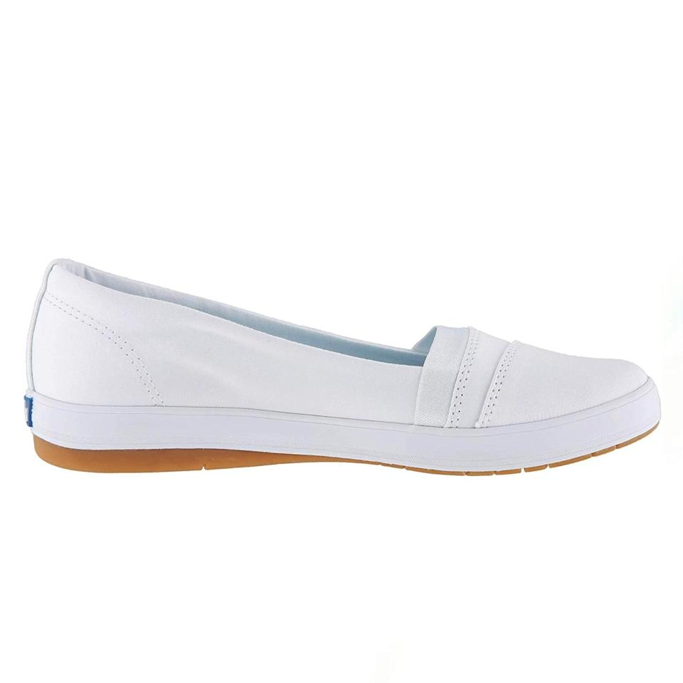 """I absolutely love the cushioned sole on these shoes. They provide a soft bed for your foot to help with long hours standing, and the shoes are light and flexible. Both these [and the Rothy's] are better for feet on the narrow side and those that don't have issues with plantar fasciitis because of the relatively flat sole. If arch and heel pain is an issue, adding an insert (or orthotic) can help as well. You may need to size up a half-size, but even an OTC insert for a little extra support could go a long way if you need it. —<em>L.M.</em> $45, Zappos. <a href=""""https://www.zappos.com/p/keds-carmel-twill-white/product/9170518/color/14"""" rel=""""nofollow noopener"""" target=""""_blank"""" data-ylk=""""slk:Get it now!"""" class=""""link rapid-noclick-resp"""">Get it now!</a>"""