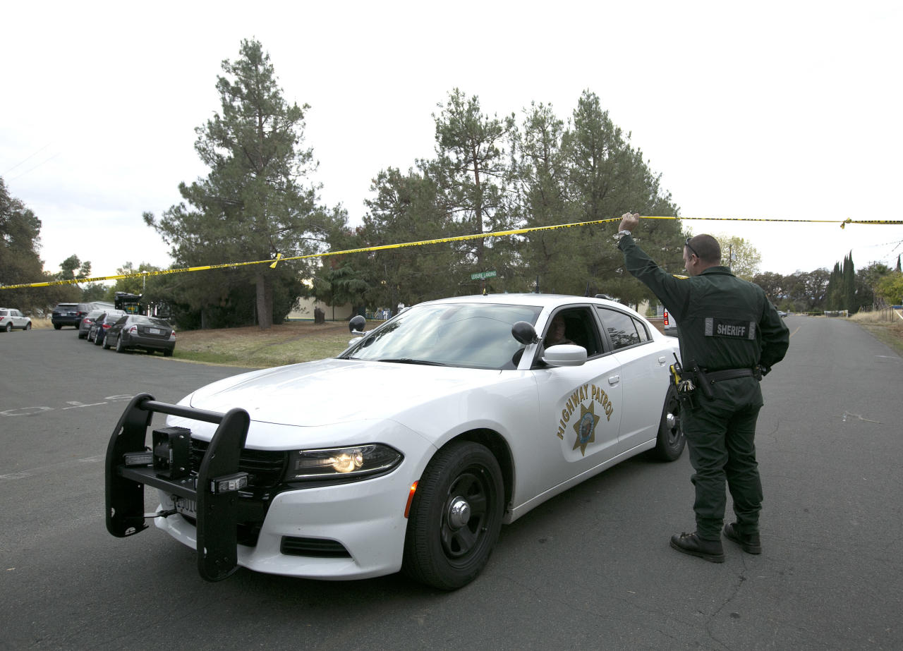 <p>A California Highway Patrol vehicle lives the Rancho Tehama Elementary school, one of the locations attacked by a lone gunman Nov. 14, 2017. (Photo: Rich Pedroncelli/AP) </p>