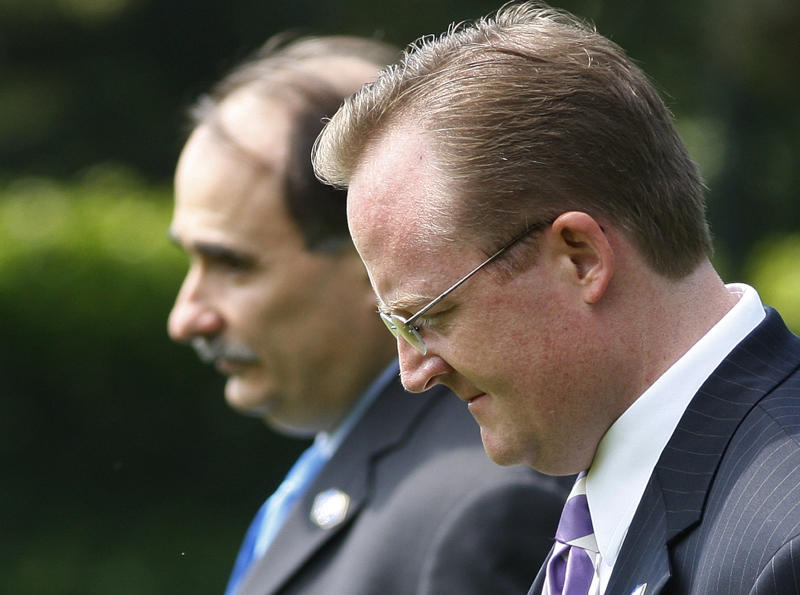 FILE - In this Aug. 11, 2009, file photo Senior White House Adviser David Axelrod, left, White House Press Secretary Robert Gibbs, right, leave with President Barack Obama, not shown, from the White House in Washington. Obama allies and former top aides are worried he has lost his voice on his central theme of economic opportunity, silenced by a trio of recent troubles. Axelrod and Gibbs are pressing Obama's current aides to let the president stake out a big vision once again, not only to put a focus on his second term but to move away from the controversies engulfing the White House.  (AP Photo/Ron Edmonds, File)