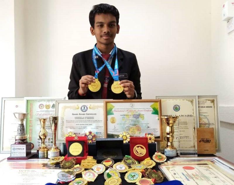 Karthikgesan showing his gold medals that he won for creating eco-friendly pots in the recent virtual global competition. — Picture courtesy of Karthikgesan Santharasekaran