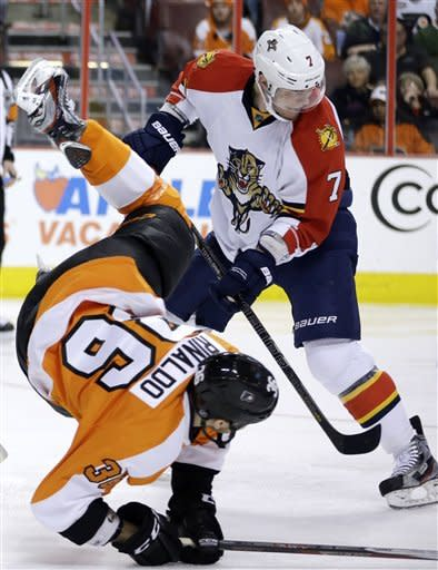 Philadelphia Flyers' Zac Rinaldo, left, is upended by Florida Panthers' Dmitry Kulikov, of Russia, during the second period of an NHL hockey game, Thursday, Feb. 7, 2013, in Philadelphia. (AP Photo/Matt Slocum)