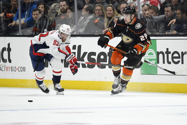 Washington Capitals center Evgeny Kuznetsov, left, and Anaheim Ducks center Devin Shore compete for the puck during the second period of an NHL hockey game Friday, Dec. 6, 2019, in Anaheim, Calif. (AP Photo/Mark J. Terrill)