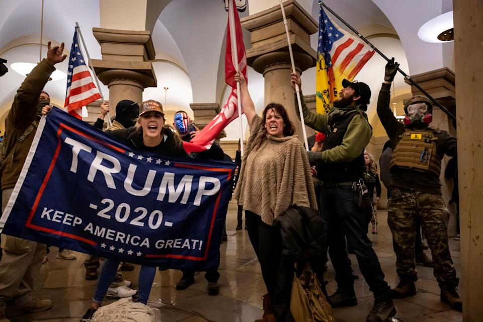 Supporters of US President Donald Trump protest inside the US Capitol after storming the building. Source: Getty