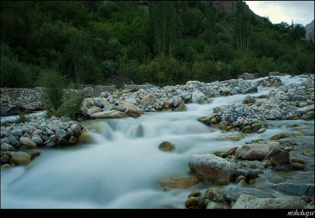 The silky smooth waters of a tributary stream of the Shayok River.